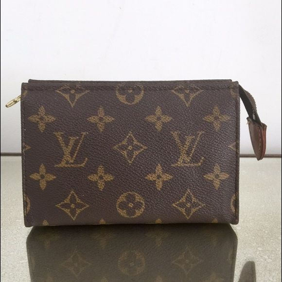 """Louis Vuitton toiletry pouch 15 monogram cosmetic Authentic Louis Vuitton monogram toiletry pouch 15. 5.9"""" x 3.8"""" x 1.6"""". Good condition date code SD0969. Had some peeling which I had professionally removed. Louis Vuitton Bags Cosmetic Bags & Cases"""