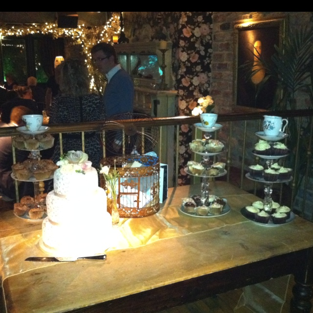 Cake stands made from candle sticks and vintage cups and saucers