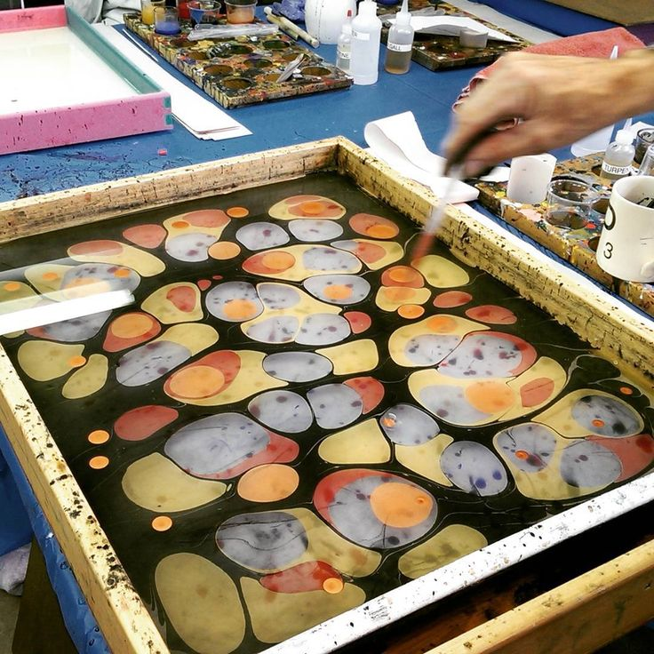 """Marbled paper by Barb Skoog. Referring to the tray of colors, Barb writes, """"I want to be here. Doing this. Look at that tank...those colors! Instead, I'm at the airport, in the security line for the past 45 minutes (WTH Dulles?!). Usually this kind of thing doesn't get under my skin. But that was before I learned how to make my own historic marbling paints. Now, every second in the security line means fewer seconds in the studio with pigments and a muller...."""""""