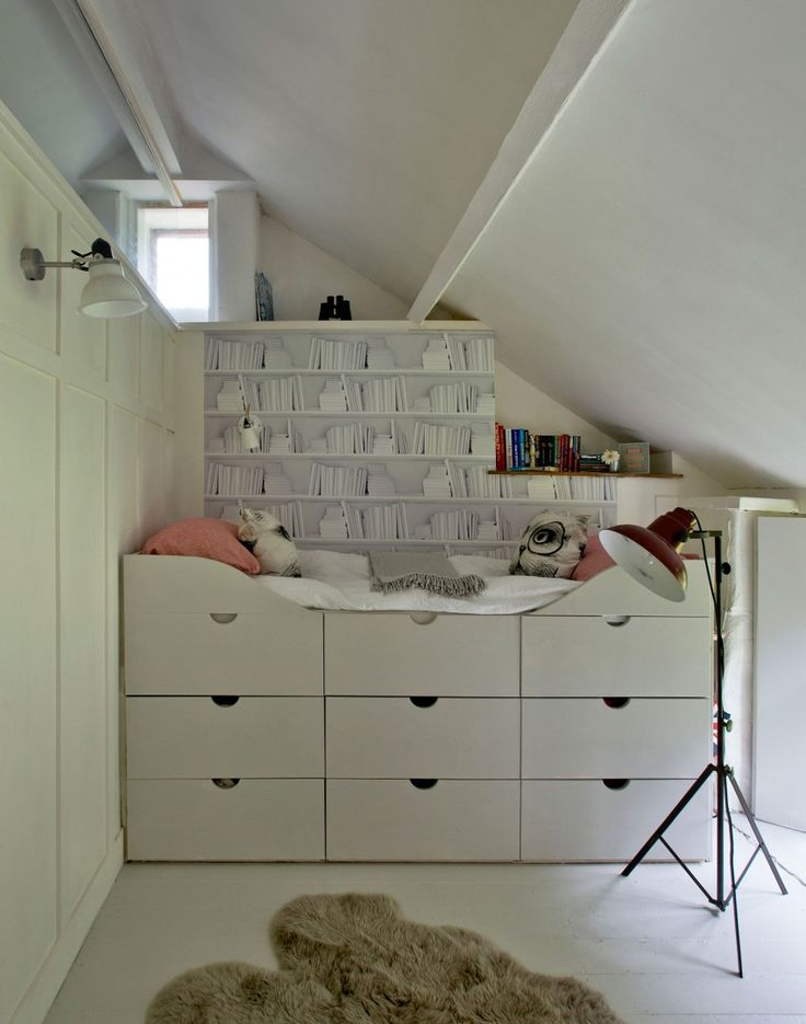 If your bedroom is on the small side, consider investing in a cabin bed. It zones the (limited) space and the raised section can incorporate lots of storage, too. Trick the eye into seeing a library of books rather than plain wardrobe doors.
