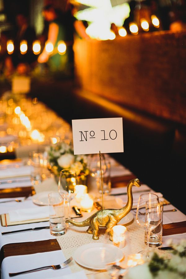 gold animal figurine table number, photo by Chaz Cruz http://ruffledblog.com/soho-wedding-with-modern-and-industrial-touches #tablenumbers #figurines