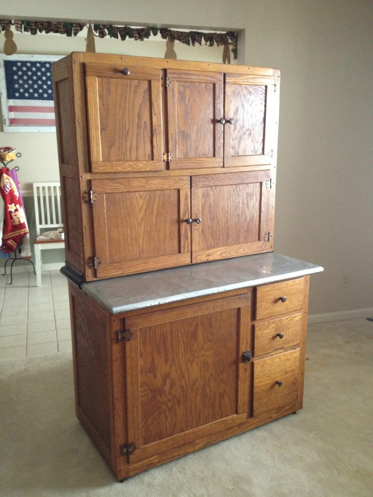 old vintage antique oak hoosier kitchen cabinet with flour