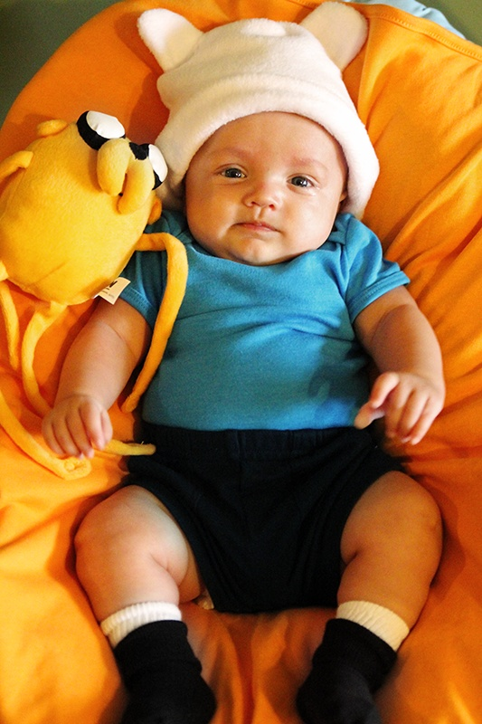 1 of 2 costumes I made for baby this year. Finn from Adventure Time! Hat from Jacqui's Preemie Pride, Inc (via amazon.com), onesie from American Apparel, Jake plushie made by Cartoon Network, blue shorts, white socks and black booties from Buy Buy Baby.