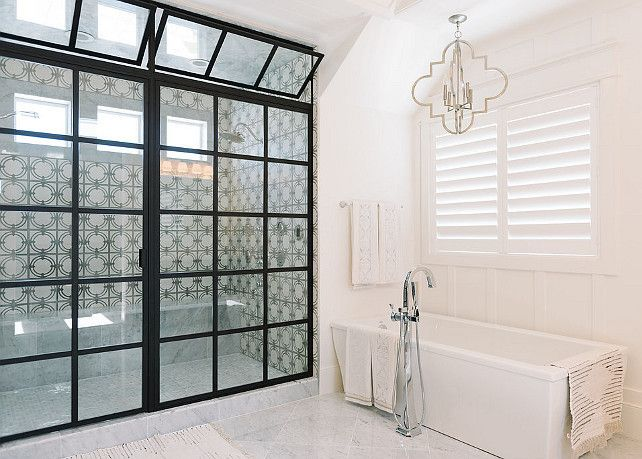 bathroom glass and steel shower enclosure via home bunch