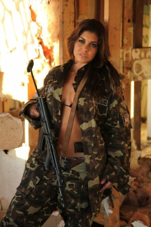 300 followers! Celebration! Michelle Viscusi with the Hungarian AMD-65 and the FEG PA-63 in the waist.