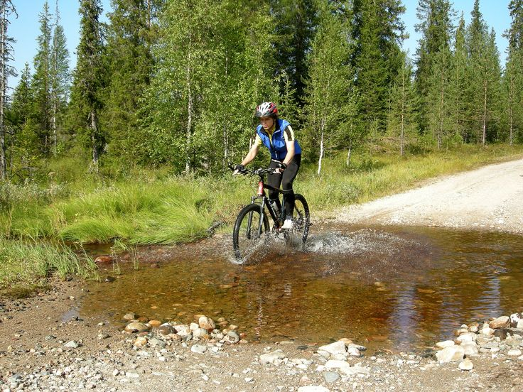Biking in the National Park Syöte, Taivalkoski, Lapland, Finland