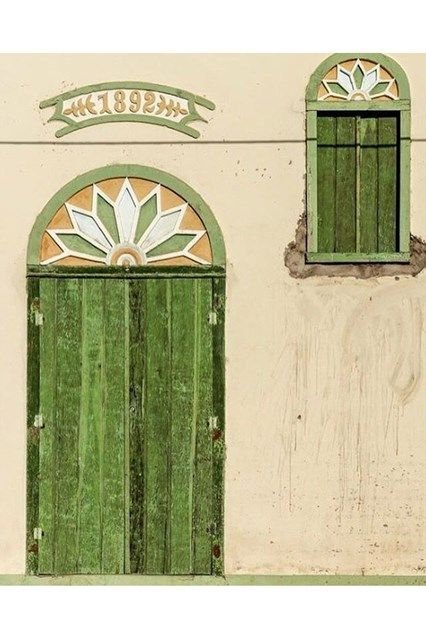 Green Matching Shutters - See the most beautiful doors from all around the world courtesy of Door J'adore pics from their regular Instagram takeovers on the House & Garden account.
