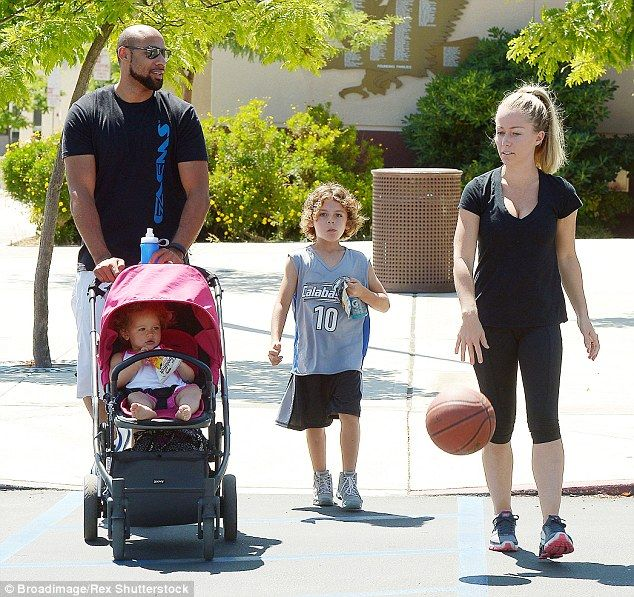 Marriage woes: Kendra with husband Hank Baskett and their children Hank and Alijah in Cala...
