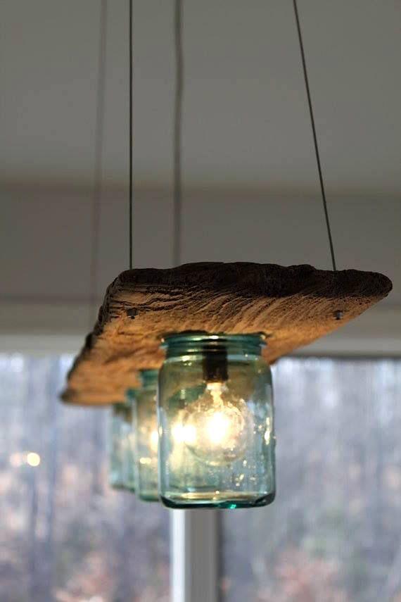 Luminaire avec vieille planche et pots Masson