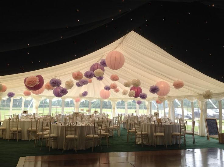 Stunning wedding marquee with starlight roof linings and pink pompoms! #summerwedding #starlightroof