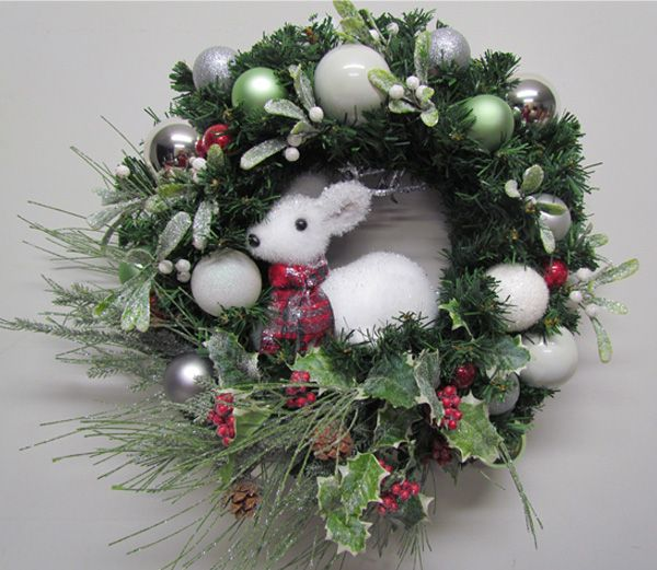 Charming mistletoe and holly wreath with white deer by Miss Haberdash Christmas.