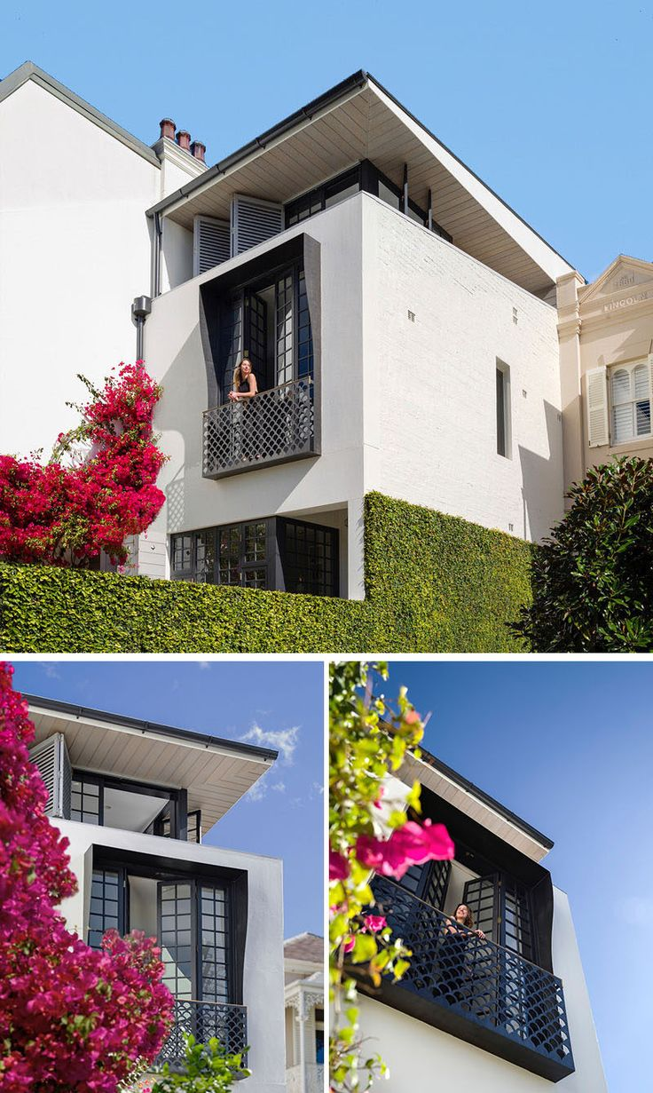 Stepping through to the front terrace of this modern house, there's a bright pink bougainvillea, and when it blooms it adds a bright pop of color to the white and black house.