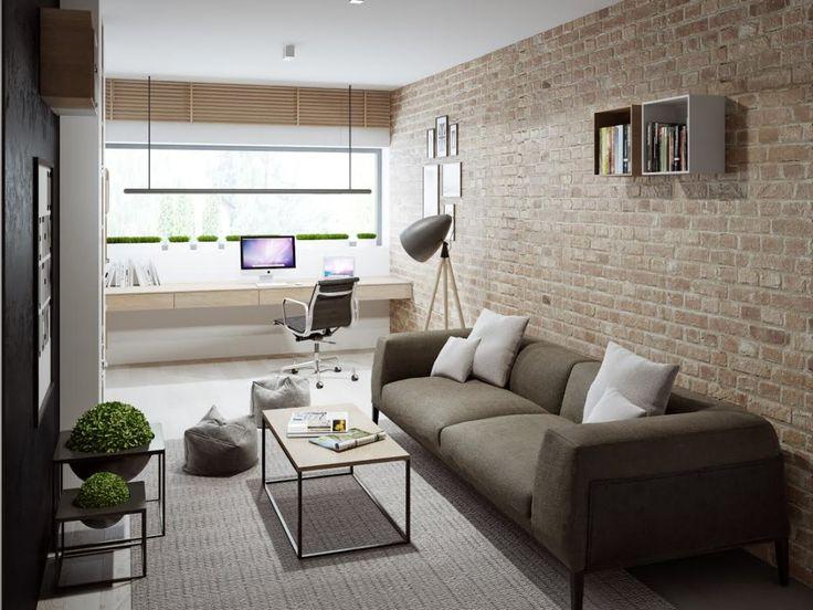 Cegła na ścianie oraz industrialny charakter lampy stojącej wprowadza do aranżowanej przestrzeni loftowy charakter