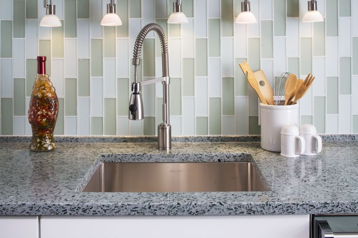 Tested and certified by NSF International, Vetrazzo is strong, highly resistant to moisture, heat, chemicals and mold, and has been judged to be the most eco-friendly of all countertops.  Vetrazzo's recycled glass comes from windows, dinnerware, stemware, windshields, stained glass, reclaimed glass from building demolitions, laboratory glass, traffic lights and other unusual sources. It requires professional fabrication, but hey, that's what we are here for!