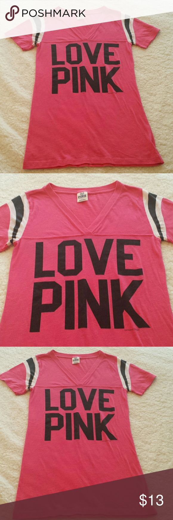 PINK VS V-Neck T-Shirt. Size Small. Pink, black, and white short sleeve , v-neck t-shirt by Victoria's Secret PINK. Pics of front and back are posted. Good used condition. No holes or stains. Size Small. Fit is TTS, not oversized. PINK Victoria's Secret Tops Tees - Short Sleeve