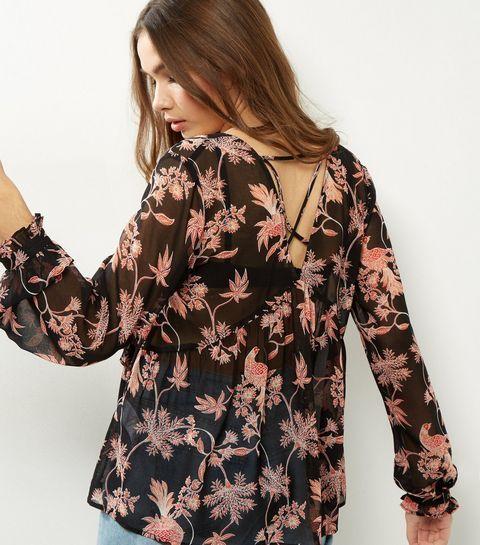 Top noir transparent à imprimé floral et brides croisées dans le dos