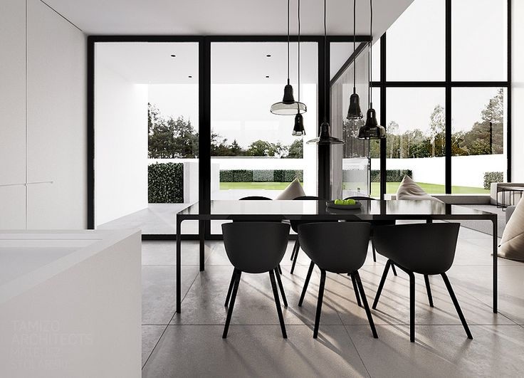 This Clean Interior Design Of A Detached House In Warsaw By Tamizo Architects Depicts Black Dining ChairsDining Room