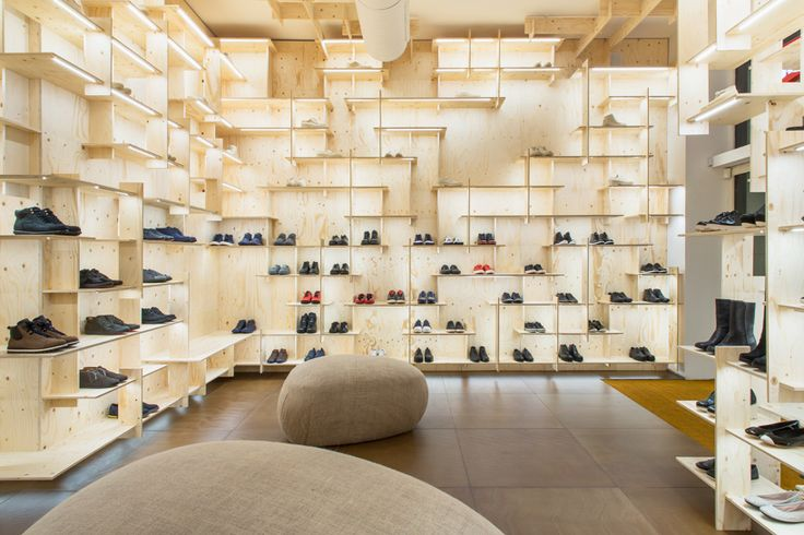 kengo kuma delineates milan camper store with gridded plywood shelves