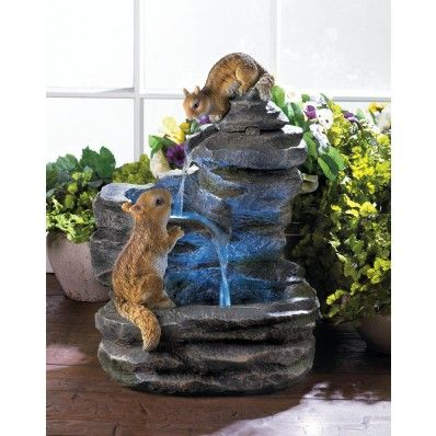 Youll be hard-pressed to find a cuter fountain than this! Give your yard or garden an extra dose of charm with this cascading water fountains two cheery chipmunks perched on the rock-inspired sculpture. Submersible electric pump included.