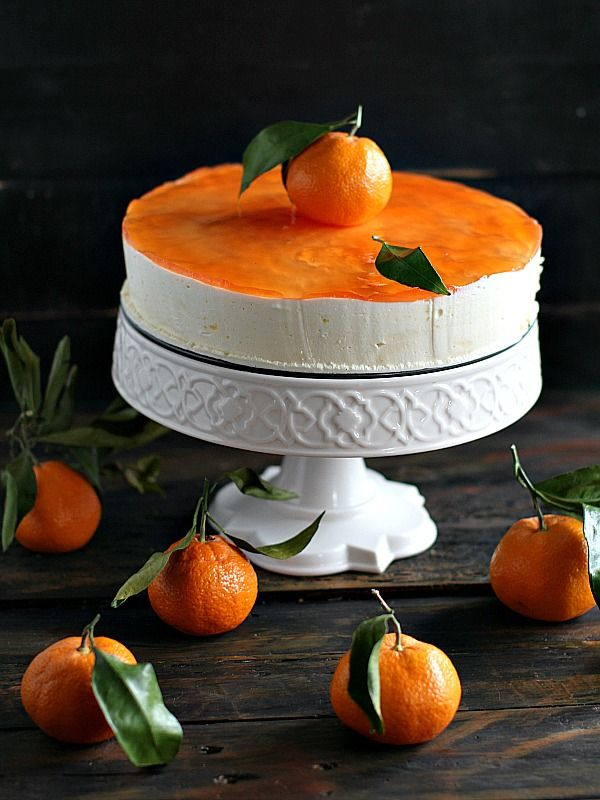 A delightfully airy, creamy and aromatic clementine mousse cake over delicious yellow cake and topped with sweet and flavorful peach jelly.