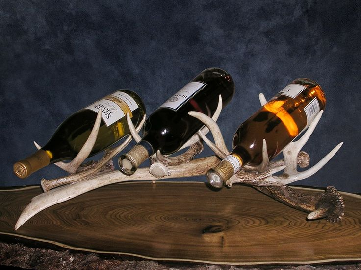 Antler Wine Rack holds up to 3 bottles.  Perfect for display on top of the bar, kitchen island and sofa table.