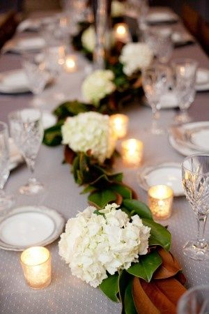 love love love | magnolia leaves with white blooms and votives | simple and beautiful | table decorating ideas | LFF Designs | www.facebook.com/LFFdesigns