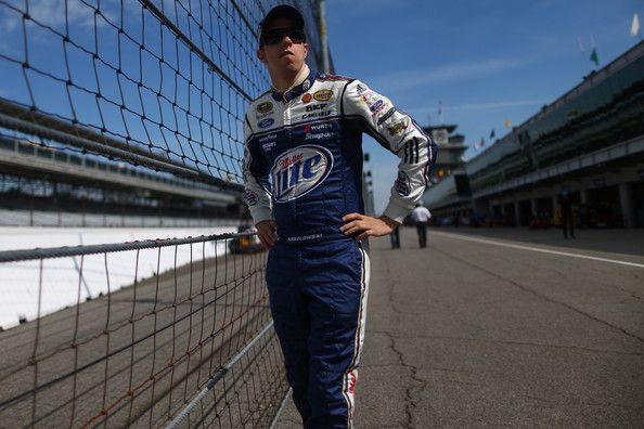 Brad Keselowski Photos - Brad Keselowski, driver of the #2 Miller Lite Ford, looks on from the garage area during practice for the NASCAR Sprint Cup Series Samuel Deeds 400 At The Brickyard at Indianapolis Motor Speedway on July 26, 2013 in Indianapolis, Indiana. - Indianapolis Motor Speedway: Day 2