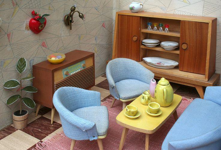 Communist dollhouses at http://www.messynessychic.com/2015/06/24/communist-dollhouses-stasi-chic-in-miniature/