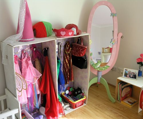 Simple dress up centre. Carboard wouldn't hold up here but I like the flat surface up top for hats. We have a lot of hats!