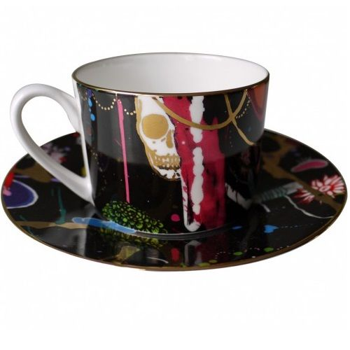 Thunderclap Limited Edition Cup and Saucer: Thunderclap Dawn Limited Edition Cup and Saucer  This cup and saucer set is literally dripping in gold... 24 carat gold to be exact! Lovingly designed by British artist Dan Baldwin. He is known for blurring the line between abstract and figurative painting by creating a landscape that simultaneously reflects reality, the power of the imagination and the private, inner workings of his mind. Featuring gold skulls, swallows and razor blades, this…