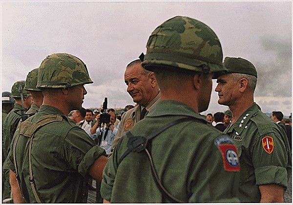 historicaltimes:A soldier being decorated by President Lyndon B. Johnson. General William Westmoreland is standing by via reddit