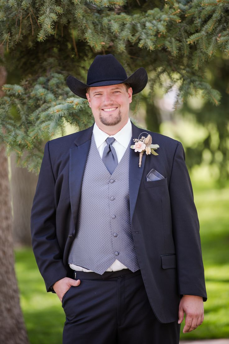 Charcoal gray three-piece suit, black cowboy hat, country-western groom style // Katie Corinne Photography