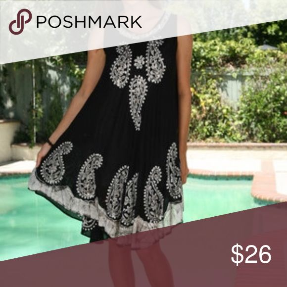 BOGO 1/2 off NWT Gorgeous Bathing cover/dress An exotic printed black and silver summer dress. Stay cool in the spring break heat. This swim suit cover/dress is see through. A slip is need if wearing as a dress. New With Tags, Never Worn, and from distributor(: Graciously open to reasonable offers  Dresses Midi