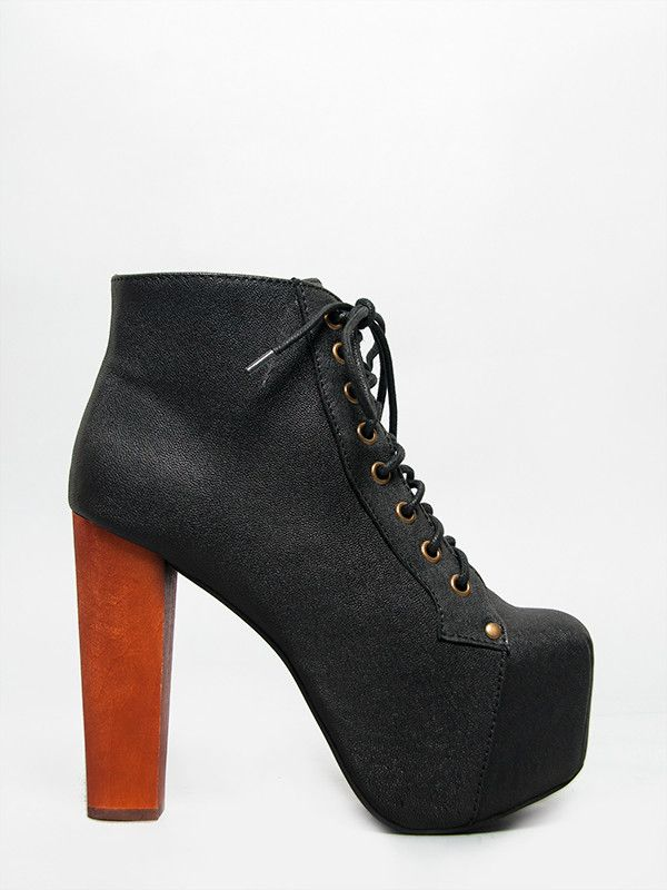 - Unleash your wild side in Gorgeous - Premium leather booties in Jeffrey Campbell's classic Lita. - Lace-up ankle boots feature a chunky heel and elevated platform for dramatic height. - Cushioned in