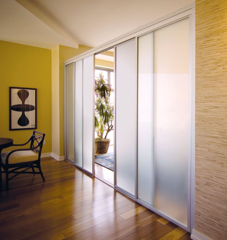 Custom room dividers made with frosted glass and sliver frame finish. Open up for an open floor plan feel or close for privacy.