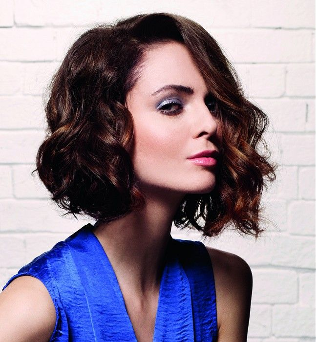 Hairstyles for square faces - A side parting and tousled asymmetric bob is a stunning cut for a square face shape. As one side of the hair is cut to the jaw line and the opposite side falls below, this cut completely changes the balance of an angular jaw line.