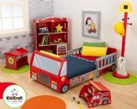 Fire Truck Toddler Bed by Kidkraft      Convenient storage compartment      Ladder cut-outs on sides that double as bed rail      Silk-screened details      Which boy doesn't love this?      Made of composite wood materials and plastic      142.24 cm L x 74.29 cm W x 109.85 cm L