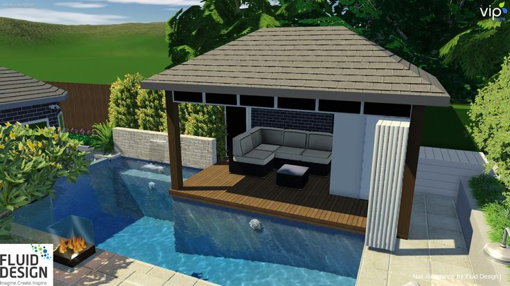 Pool w/ stone water feature wall & cabana w/ stacking glass doors opening to the pool.