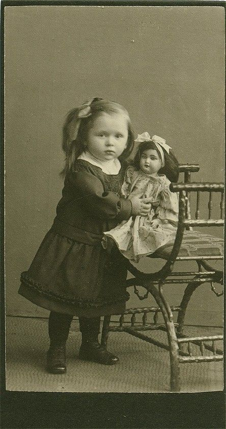 Antique photo of a darling little girl and her doll circa 1890 - 1910.
