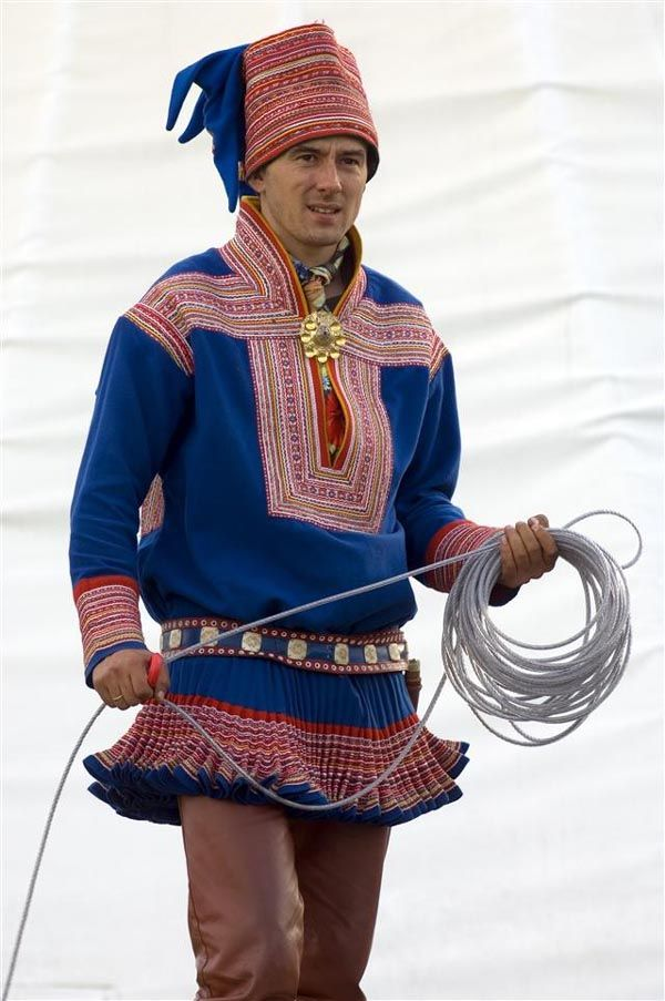 Worn by the Sami people, (also spelled Saami), one of the indigenous people of northern Europe inhabiting Sapmi, which today encompasses parts of northern Sweden, Norway, Finland and the Kola Peninsula of Russia, as well as the border area between south and middle Sweden.     This form of clothing, known as gakti, is traditionally worn both in ceremonial contexts and while working, particularly when herding reindeer.