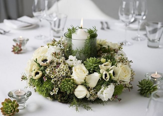 Table Centerpiece With Wreath Of White Flowers And Greenery