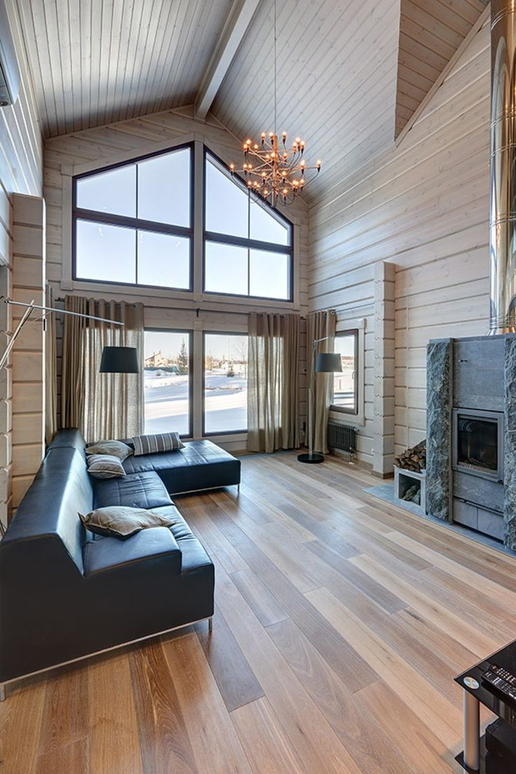 The Serenata house is a popular, traditional log home with classic log house windows.
