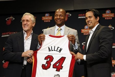 Miami Heat president Pat Riley, left, guard Ray Allen, center, and head coach Erik Spoelstra, right hold up Allen's jersey after Allen signed an NBA basketball contract with the Heat (AP)