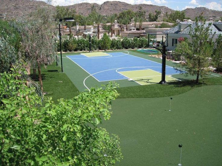 Perfect backyard #basketball #court with putting green and in-ground trampoline.
