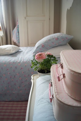 How pretty! spray paint the suitcases for girls room, or other colors for other bedrooms