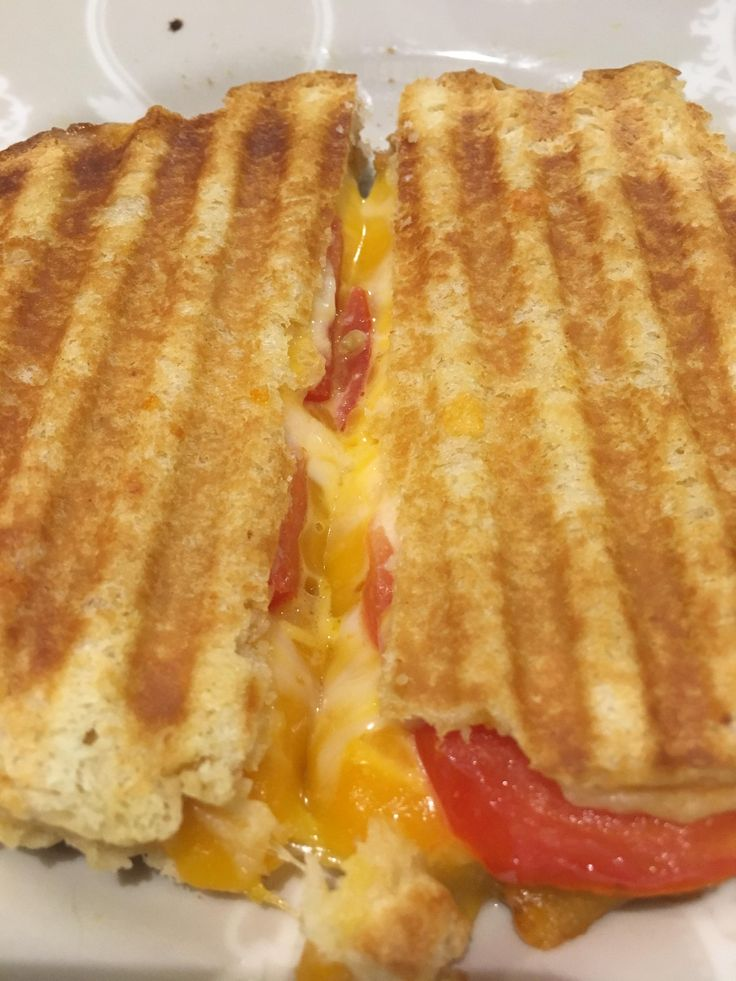 Gooey colby jack and cheddar with a tomato on fresh white bread #grilledcheese #food #yum #foodporn #cheese #sandwich #recipe #lunch #foodie