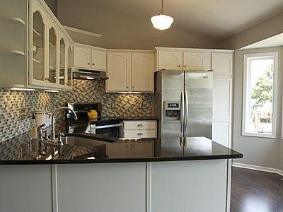 white kitchen, black granite and backsplash