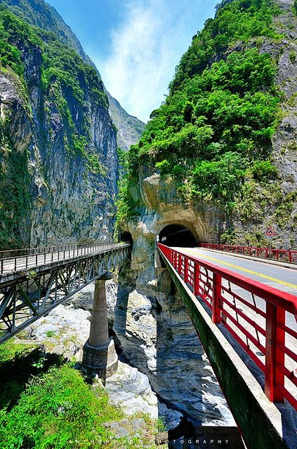 Taroko Gorge (Taiwan). 'Rising above the froth of the blue-green Liwu River, the marble walls (yes, marble!) of Taroko Gorge swirl with the colours of a master's palette. Add in grey mist, lush vegetation and waterfalls seemingly tumbling down from heaven, and you truly have a classic landscape.' http://www.lonelyplanet.com/taiwan/east-coast/taroko-gorge