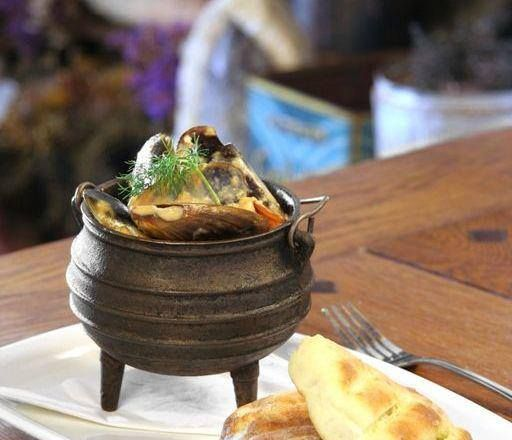 People come from far and wide to sample our infamous Strandlopers Mussel Pot! Picture it! Mussels smothered in a creamed smoked tomato sauce, served with freshly made rooster bread. Shall we get your table ready?