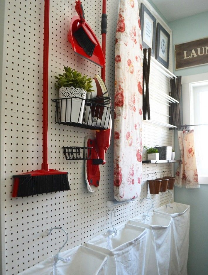 Pegboard Organization Ideas For The Garage And Beyond  (I like the framed artwork alongside the organization.  It brings clarity and class to the area. So does the window.)